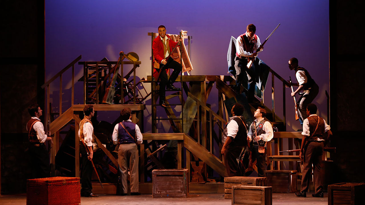 Revolutionaries atop the barricade in Les Miserables